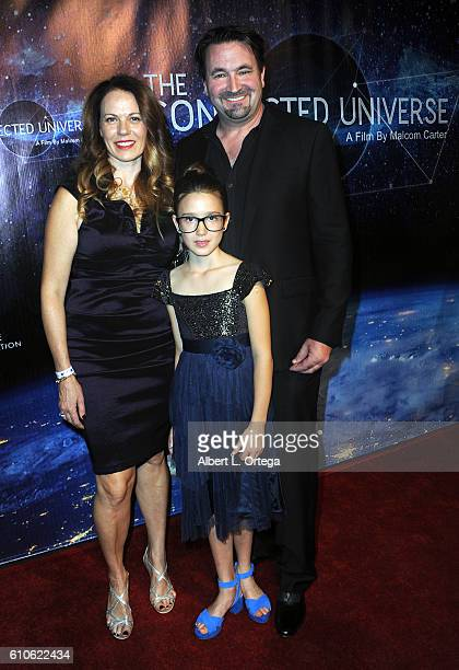 Director Malcom Carter Dr Lesya Anna Adehl and Sophie Jade Adehl arrive for the Premiere Of 'The Connected Universe' at DGA Theater on September 26...