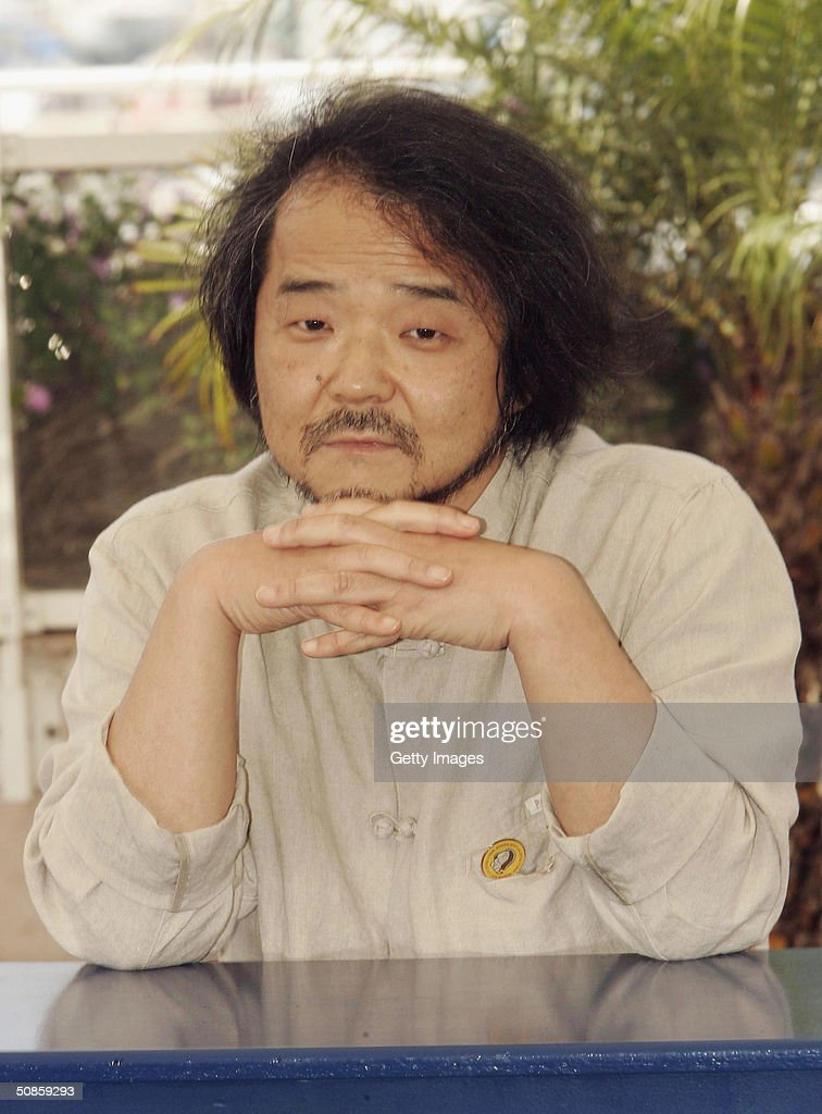 Director Mamoru Oshii attends photocall for 'Innocence' at Le Palais des Festival at the 57th Cannes Film Festival on May 20, 2004 in Cannes, France.