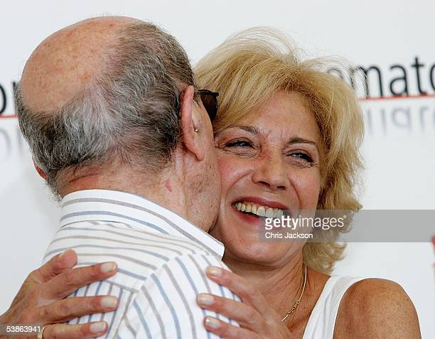 Director Manoel de Oliveira kisses actress Marisa Paredes at the photo call for Espelho Magico as part of the 62nd Venice Film Festival on September...