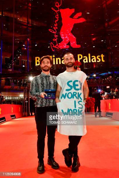 Director Manuel Abramovich and Bogdan Georgescu pose on the red carpet after receiving the Silver Bear jury prize in the short film category for the...