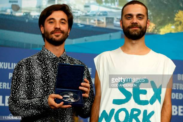 Director Manuel Abramovich and Bogdan Georgescu pose with the Silver Bear jury prize in the short film category for the movie 'Blue Boy' during a...