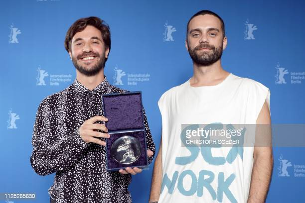 Director Manuel Abramovich and Bogdan Georgescu pose with the Silver Bear jury prize in the short film category for the movie 'Blue Boy' during the...