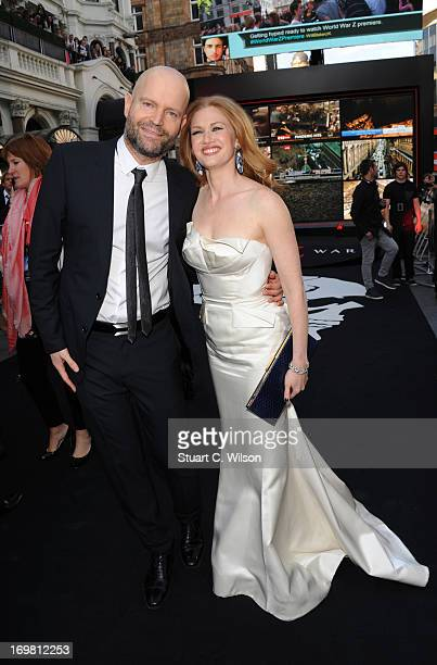 director Marc Forster and Mireille Enos attend the World Premiere of 'World War Z' at The Empire Cinema on June 2 2013 in London England