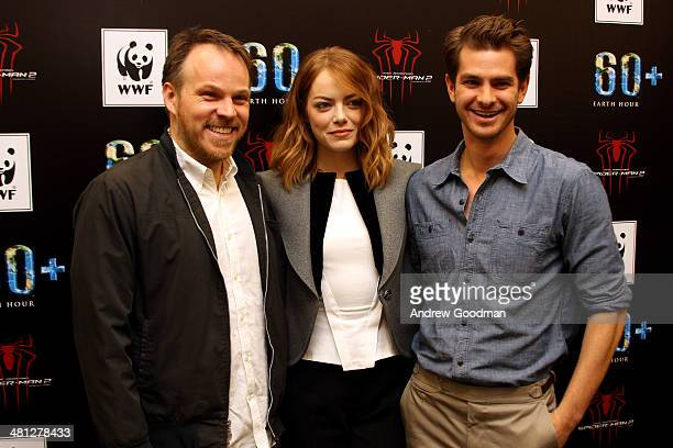 Director Marc Webb Emma Stone and Andrew Garfield of The Amazing SpiderMan 2 attends the Earth Hour KickOff with SpiderMan The First Super Hero...