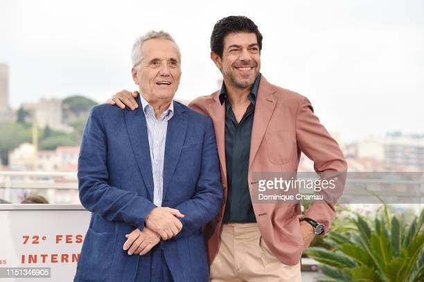 Director Marco Bellocchio and Pierfrancesco Favino attend thephotocall for The Traitor during the 72nd annual Cannes Film Festival on May 24 2019 in...