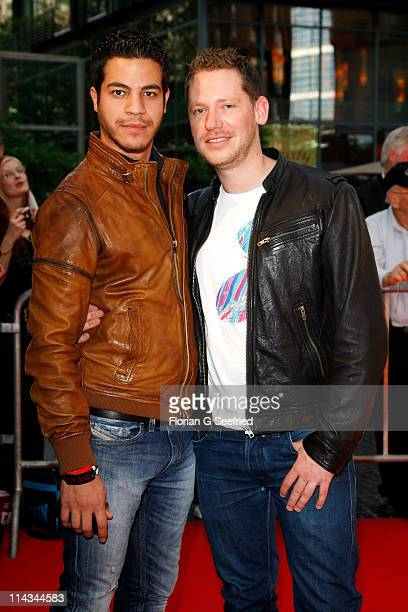 Director Marco Kreuzpaintner and partner Gilardi attend the 'Grand Opening Cinema Berlin' with the screening of 'Pirates Of The Caribbean: On...