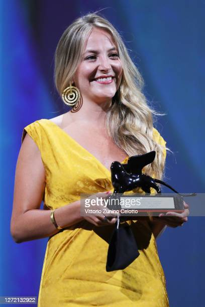 Director Mariana Saffon poses with the Orizzonti Award for Best Short Film during the closing ceremony at the 77th Venice Film Festival on September...