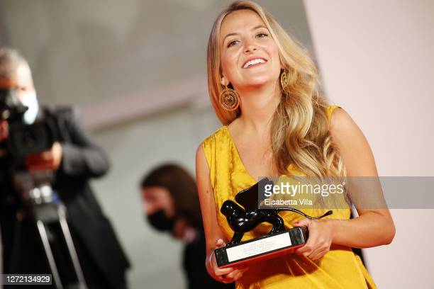 Director Mariana Saffon poses with the Orizzonti Award for Best Short Film during the winners photocall at the 77th Venice Film Festival on September...