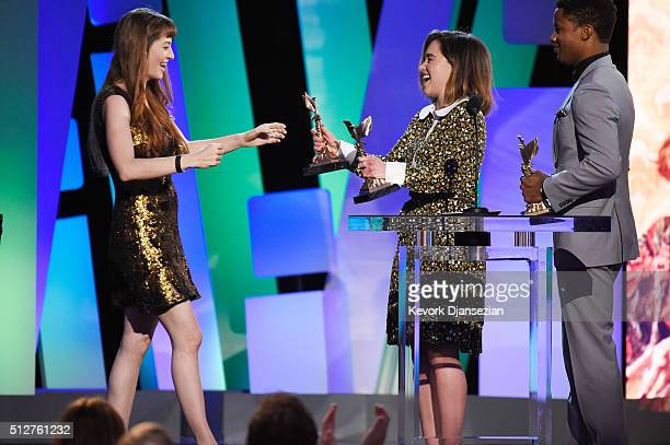 Director Marielle Heller accepts the Best First Feature award for 'The Diary of a Teenage Girl' from actors Emilia Clarke and Nate Parker onstage...