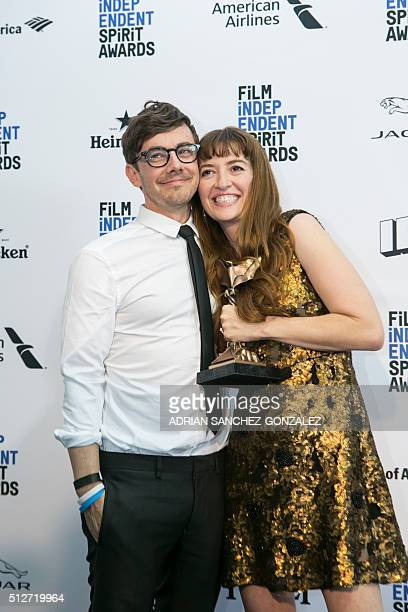 Director Marielle Heller and her husband Jorma Taccone pose with her award for best first feature for 'Diary of a Teenage Girl' at the 2016...