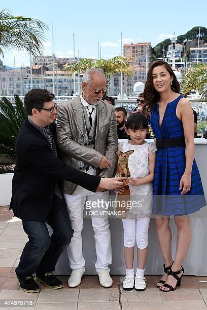 US director Mark Osborne Japanese actor Masahiko Tsugawa Japanese actress Rio Suzuki and Japanese actress Asaka Seto pose during a photocall for the...