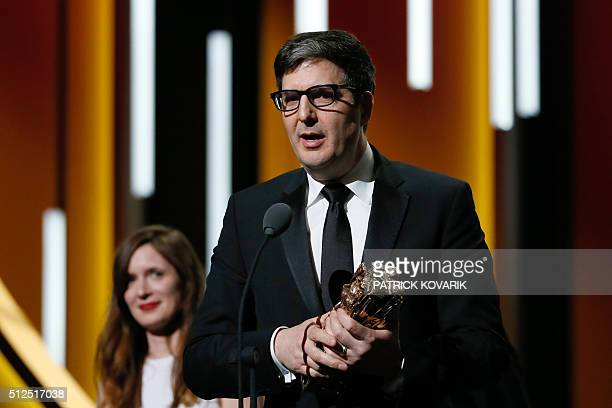 US director Mark Osborne reacts after winning the Best Animated Feature award for Le Petit Prince during the 41st edition of the Cesar Ceremony at...