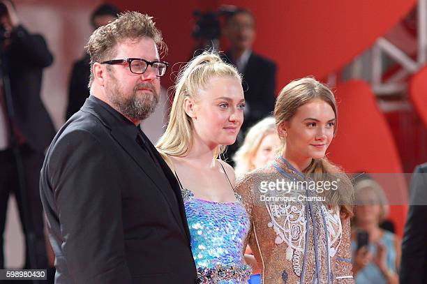 Director Martin Koolhoven actresses Dakota Fanning and Emilia Jones attends the premiere of 'Brimstone' during the 73rd Venice Film Festival at Sala...