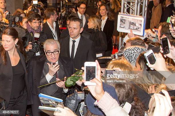Director Martin Scorcese signs autographs as he attends the 'The Wolf of Wall Street' Paris Premiere at Cinema Gaumont Opera on December 9 2013 in...