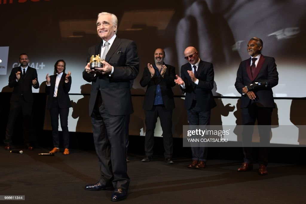 TOPSHOT - US director Martin Scorsese acknowledges applause from French directors Jacques Audiard (2ndR), Cedric Klapisch (3rdR) after receiving from the French Association of Filmmakers (La Société des realisateurs de films, SRF) the Carosse d'Or 2018 award (Golden Coach Award 2018) during a ceremony on May 9, 2018 at the 71st edition of the Cannes Film Festival in Cannes, southern France.