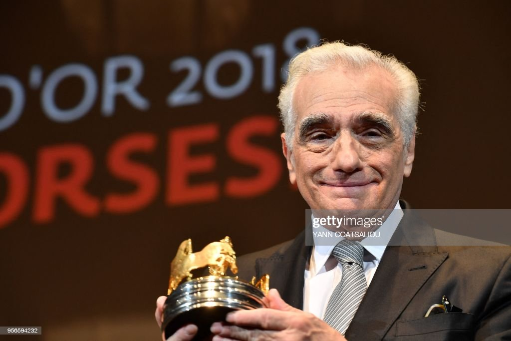 TOPSHOT - US director Martin Scorsese poses after receiving from the French Association of Filmmakers (La Société des realisateurs de films, SRF) the Carosse d'Or 2018 award (Golden Coach Award 2018) during a ceremony on May 9, 2018 at the 71st edition of the Cannes Film Festival in Cannes, southern France.
