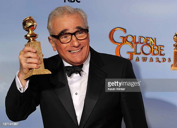 "Director Martin Scorsese poses in the press room with the Best Director for a Motion Picture award for ""Hugo"" at the 69th Annual Golden Globe Awards..."