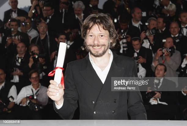 """Director Mathieu Amalric poses with his Best Director award for the film  On Tour"""" at the Palme d'Or Award Ceremony photocall held at the Palais des..."""