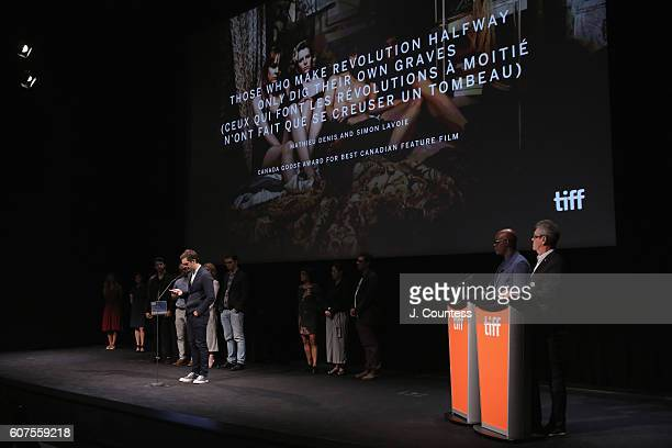 Director Mathieu Denis receives the Grey Goose Award for Best Canadian Feature Film for 'Those Who Make Revolution Halfway Only Dig Their Own Graves'...