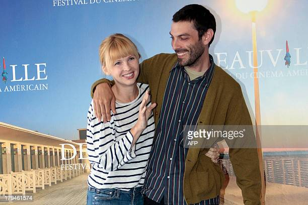 US director Matt Creed and US actress Amy Grantham pose during a photocall to present 'Lily' his latest movie on September 4 2013 as part of the...