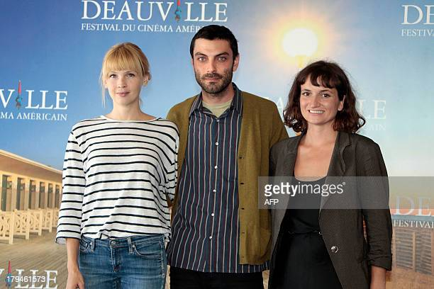 US director Matt Creed US producer Isabella Tzenkova and US actress Amy Grantham pose during a photocall to present 'Lily' his latest movie on...