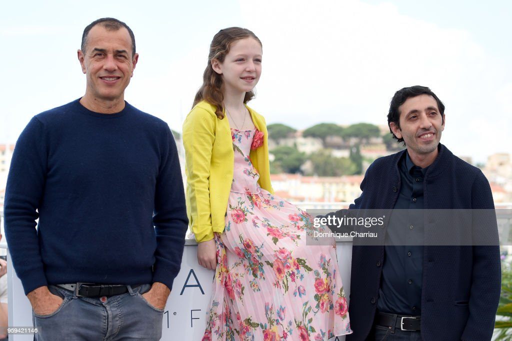 Director Matteo Garrone, actress Alida Baldari Calabria and Marcello Fonte attend 'Dogman' Photocall during the 71st annual Cannes Film Festival at Palais des Festivals on May 17, 2018 in Cannes, France.
