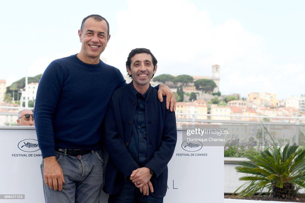 Director Matteo Garrone (L) and actor Marcello Fonte attend 'Dogman' Photocall during the 71st annual Cannes Film Festival at Palais des Festivals on May 17, 2018 in Cannes, France.