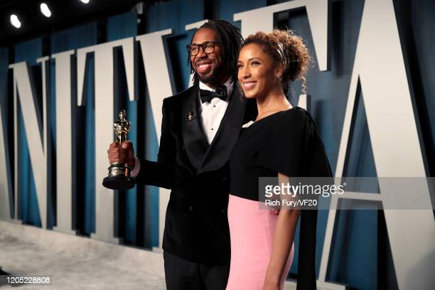 """Director Matthew A. Cherry and Candice Wilson pose with the Oscar for Best Animated Short Film for """"Hair Love"""" as they attend attends the 2020 Vanity..."""