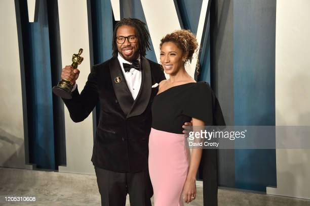 """Director Matthew A. Cherry and Candice Wilson pose with the Oscar for Best Animated Short Film for """"Hair Love"""" as they attend the 2020 Vanity Fair..."""