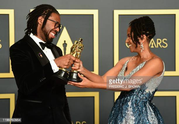 """Director Matthew A. Cherry and Karen Rupert Toliver pose in the press room with the Oscar for Best Animated Short Film for """"Hair Love"""" during the..."""
