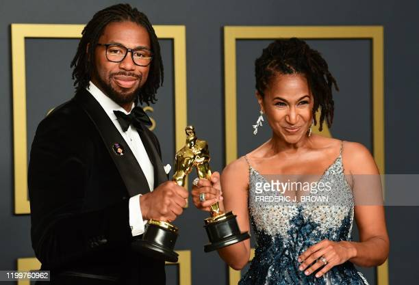 US director Matthew A Cherry and Karen Rupert Toliver pose in the press room with the Oscar for Best Animated Short Film for Hair Love during the...