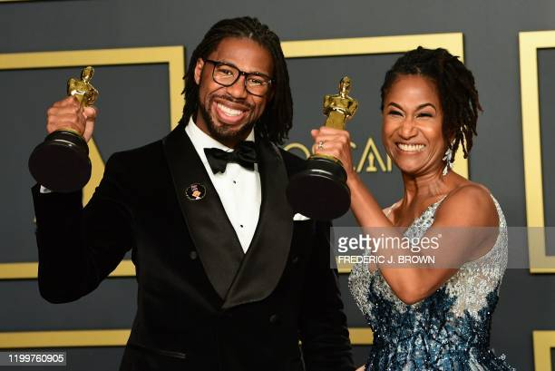 """Director Matthew A. Cherry and Karen Rupert Toliver poses in the press room with the Oscar for Best Animated Short Film for """"Hair Love"""" during the..."""