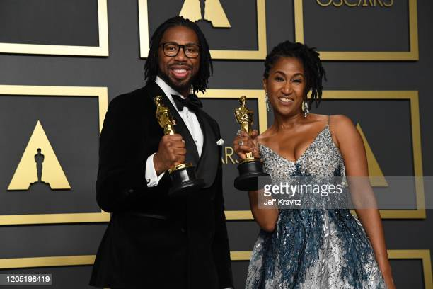 """Director Matthew A Cherry and producer Karen Rupert Toliver winners of the Animated Short Film award for """"Hair Love"""" pose in the press room during..."""