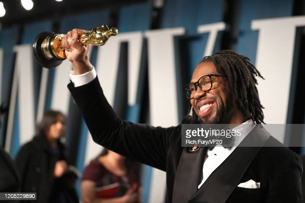 """Director Matthew A. Cherry poses with the Oscar for Best Animated Short Film for """"Hair Love"""" as he attends the 2020 Vanity Fair Oscar Party hosted by..."""