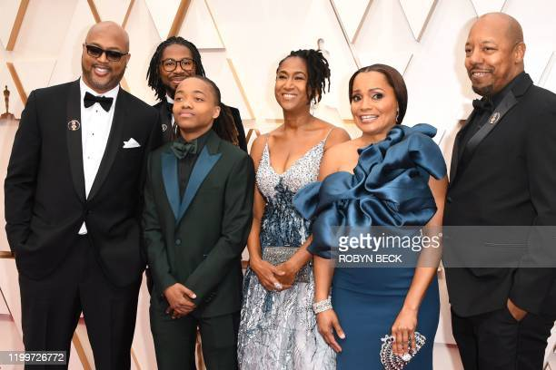 US director Matthew A Cherry US producer Karen Rupert Toliver and Deandre Arnold the Texas teen who was told his dreadlocks violated school dress...