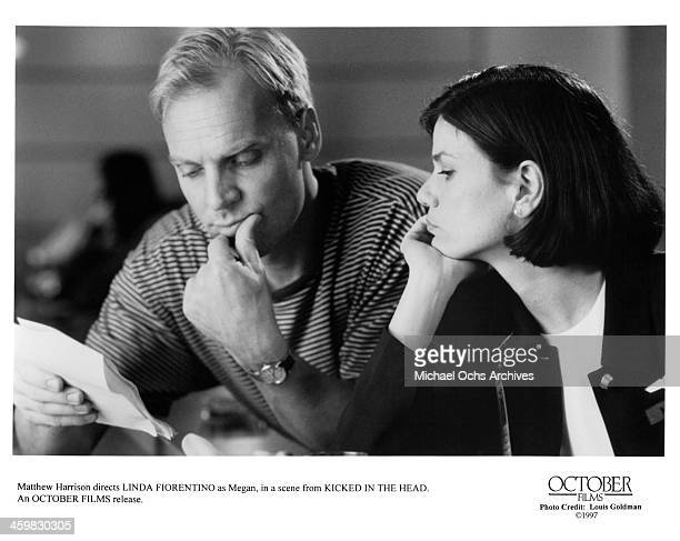 Director Matthew Harrison and actress Linda Fiorentino on set of the movie Kicked in the Head circa 1997