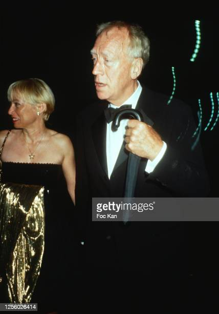 Director Max Von Sydow and wife Catherine Brelet attend the 52nd Cannes Film Festival in May 1999, in Cannes, France.