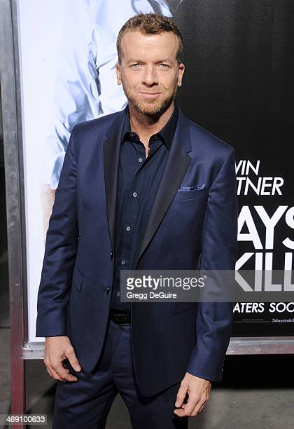 Director McG arrives at the Los Angeles premiere of 3 Days To Kill at ArcLight Cinemas on February 12 2014 in Hollywood California