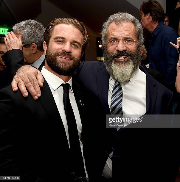 Director Mel Gibson and his son actor Milo Gibson pose at the after party for a screening of Summit Entertainment's 'Hacksaw Ridge' at the Academy of...