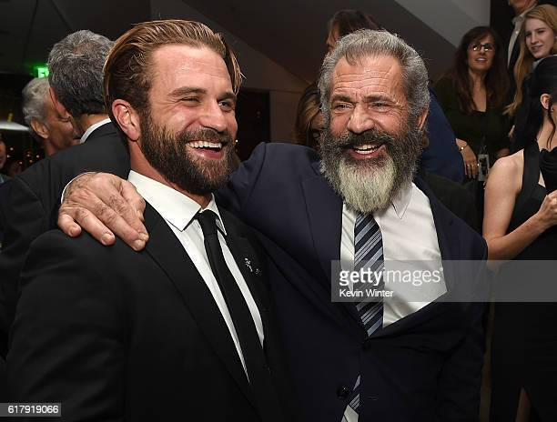 Director Mel Gibson and his son actor Milo Gibson pose at the after party for a screening of Summit Entertainment's Hacksaw Ridge at the Academy of...