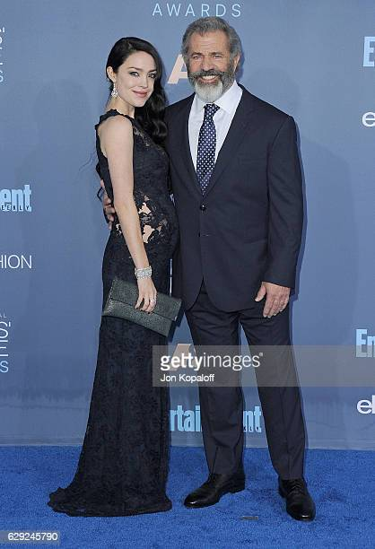 Director Mel Gibson and Rosalind Ross arrive at The 22nd Annual Critics' Choice Awards at Barker Hangar on December 11 2016 in Santa Monica California