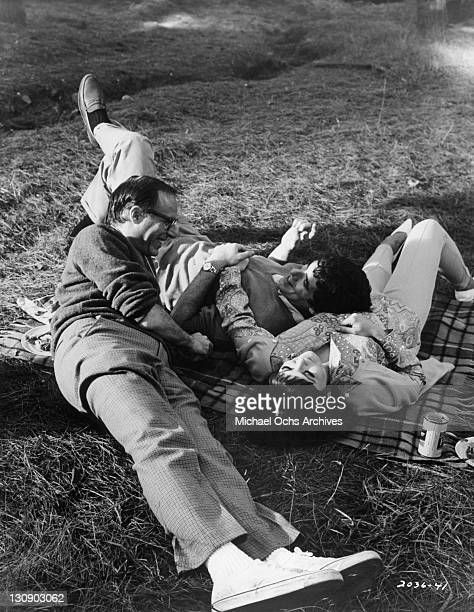Director Mel Stuart discusses an upcoming scene with Elliott Gould and Brenda Vacarro for the film 'I Love My Wife' 1970