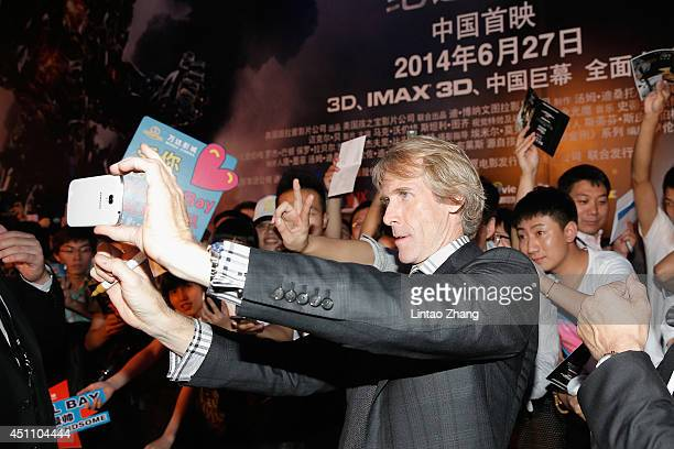 Director Michael Bay arrives the red carpet for Beijing premiere screening of 'Transformers Age of Extinction' at Wanda CBD cinema on June 23 2014 in...