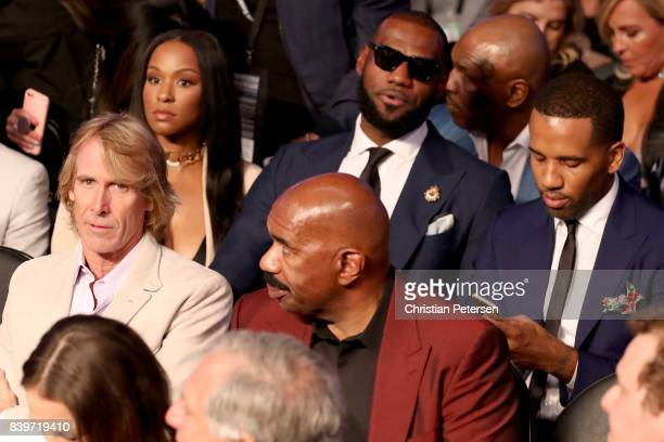 Director Michael Bay Savannah Brinson actor Steve Harvey and NBA player Lebron James attend the super welterweight boxing match between Floyd...