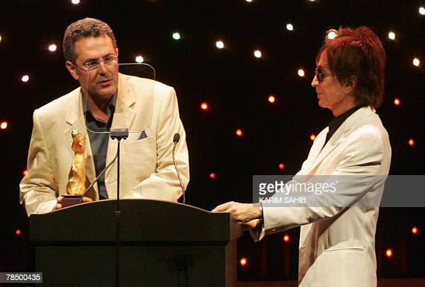US director Michael Cimino listens to Lebanese director Philippe Aractingi speaking after winning the gold Muhr award for his film 'Under the Bombs'...