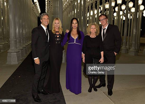 LACMA director Michael Govan wearing Gucci creative director of Gucci Frida Giannini LACMA trustee and Art Film Gala cochair Eva Chow wearing Gucci...