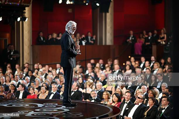 Director Michael Haneke accepts the Best Foreign Language Film award for 'Amour' seen from backstage during the Oscars held at the Dolby Theatre on...