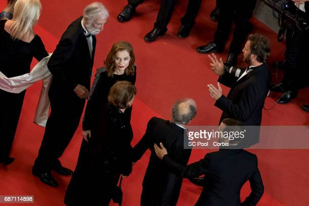 Director Michael Haneke Isabelle Hupert JeanLouis Trintignant his wife Marianne Hoepfner and Mathieu Kassovitz attend the Happy End premiere during...