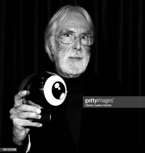 Director Michael Haneke poses with the 'A tribute to Michael Haneke' award on October 5 2013 in Zurich Switzerland