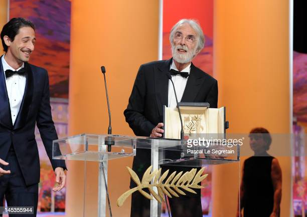 Director Michael Haneke receives the Palme D'Or for 'Amour' as actor Adrien Brody looks on onstage at the Closing Ceremony during the 65th Annual...